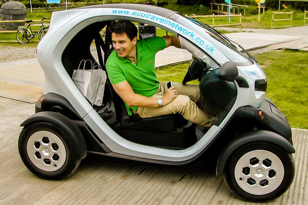 John Barrowman with the Eco Travel Network Twizy at Hay Festival